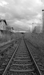 Railway. (Fotopraktic) Tags: old railroad blackandwhite abandoned geometric monochrome lines architecture composition rural germany dark nikon focus rust alone outdoor decay horizon neglected wide dramatic railway trains explore urbanexploration trainstation weathered lonely dslr peelingpaint magical contrasts bnw atmospheric infinite decaying vastness bwphoto melancholic vast urbex sharpness converging ruralexploration strcuture d5300