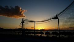After a long day at beach (Argyro...) Tags: sunset summer sky cloud sunlight beach umbrella nets