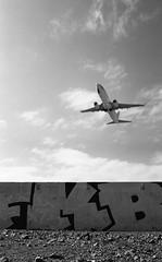 (eddieddieddie) Tags: newzealand bw streetart graffiti 80s agfa jetplane caffenolc 135format 35mmfilmscanningwellington