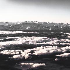 Alpine Sunrise (DFiveRed) Tags: blackandwhite bw cloud mist snow france mountains alps window fog clouds montagne plane canon airplane switzerland blackwhite airport europe view geneva air flight peak des landing alpine valley neige nuages mont blanc massif sx50