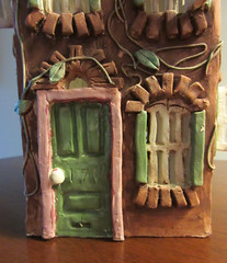 What's behind the green door? (Monceau) Tags: door sculpture green window ceramic vines shutters rowhouse