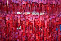 Fire God temple Beijing - red good fortune tokens (Bruce in Beijing) Tags: history temple prayer religion beijing culture traditions daoist taoist offerings springfestival shichahai qianhai xicheng jaderiver firegodtemple huodezhenjuntemple redtokens