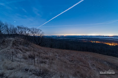 Gusty Moonlight (kevin-palmer) Tags: statepark blue trees winter sky grass night stars evening illinois contrail wind windy peremarquette clear moonlight february starry grafton 2016 twinmounds kevinpalmer peremarquettestatepark tokina1628mmf28 nikond750