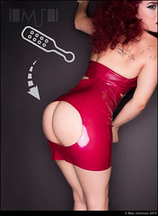 Latex Dress: Apply Paddle Here (Max Johnson) Tags: red woman hot sexy window lady female naked nude clothing model shiny dress hole bare butt bottom rear paddle cocktail latex access tight leaning spanking kinky kink bending derrier lustdesigns wendytran erinlopez felixzatknis