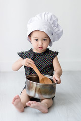 Asian child playing a chef at home. (Nuiiko) Tags: girls people food white house playing cute home cooking kitchen hat childhood female recipe table asian fun person japanese baking kid healthy child hand little eating interior small joy gray chinese paddle cook adorable lifestyle indoors domestic korean homemade human chef thai meal pan positive ideas job enjoyment preparation creep preparing concepts ingredient occupation