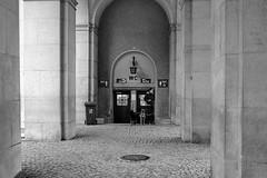 WC (.martinjakab) Tags: blackandwhite salzburg dogs monochrome architecture person austria arcade streetphotography toilet symmetry klo architektur fujifilm archway schwarzweiss hunde bogengang x100t