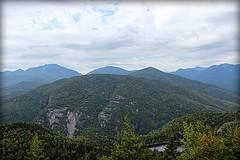 Hiking up Giant Mountain, glimpse of Chapel Pond (MonroeLea) Tags: new york mountain giant high pond peak chapel adirondacks peaks