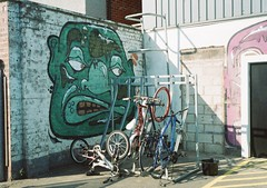 op - fargo bike rack (johnnytakespictures) Tags: street green art film face retail pen shopping graffiti paint village kodak decoration bikes olympus storage bicycles independent rack cycle indie analogue halfframe coventry fargo westmidlands warwickshire ee3 gold200 retailers fargosfordstreet