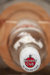 My Favourite Thing in Cuba (hectordotlee) Tags: wood travel glass vertical closeup canon stand bottle view outdoor extreme havana cuba scenic down tourist ron pointofview lookdown cap extremecloseup rum local unusual bottlecap cienfuegos attraction havanaclub downview 500d constrast canon500d