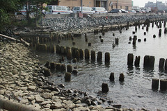 Posts and Pebbles (lefeber) Tags: ocean wood city nyc newyorkcity urban newyork abandoned water architecture pier rocks downtown waterfront atlantic worn weathered posts derelict warehouses pier54