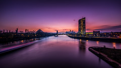 Sunset over Frankfurt/Main (lichtspur) Tags: city longexposure bridge sunset water skyline reflections river germany lowlight wasser europe glow colours sonnenuntergang view frankfurt main wideangle fluss weite belichtung ecb farben langzeitbelichtung ezb longtimeexposure reflektionen weitwinkel osthafen skaterpark osthafenbrcke