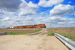 The Santa Fe Across the Heartland (Conductor Cronk) Tags: road railroad trestle bridge blue sky white weather electric clouds general diesel railway trains missouri cumulus planes electro locomotive motive plains bnsf gravel locomotives whispy es44dc gevo sd70ace es44ac es44c4