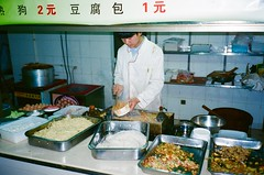 (budd) Tags: world china portrait food film face analog 35mm asia indoor olympus buddy adventure explore noodle