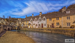 Castle Combe (JimCosseyPhotography) Tags: old uk longexposure bridge houses blur castle english beautiful clouds rural river countryside movement nikon europe pretty village 10 famous bluesky stop filter nd cottages castlecombe combe d610