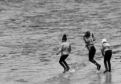 Game in waves before training of sail (patrick_milan) Tags: street people blackandwhite bw white black monochrome noir noiretblanc nb rue blanc personne streetview gens