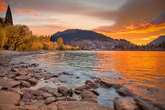 Queenstown Sunrise || QUEENSTOWN || NEW ZEALAND (rhyspope) Tags: new city autumn sunset orange lake pope tree water sunrise canon bay town rocks shoreline zealand nz queenstown 5d wakatipu rhys mkii rhyspope
