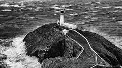 I am listening to the lighthouse's songs in B minor (lunaryuna) Tags: sea bw panorama seascape storm monochrome weather wales architecture island coast blackwhite spring solitude waves seasons lunaryuna seastack outpost anglesey northwales southstack holyheadlighthouse seasonalwonders furyoftheelements