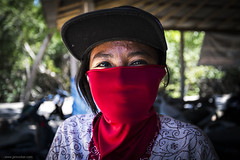 Nini (jrockar) Tags: red portrait people bali woman 3 girl beautiful face hat canon indonesia eyes pretty mask mark iii streetportrait mysterious instant l 5d local contact moment unposed 1740 mk nusalembongan