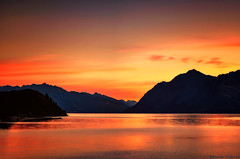 Lake of Fire (Kevin_Jeffries) Tags: light red newzealand orange mountain lake reflection nature silhouette landscape fire 50mm evening interesting lowlight nikon scenery flickr glow dusk scenic redsky silhouetted lakehawea lakeoffire nikond90 kevinjeffries