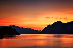 Lake of Fire (Kevin_Jeffries) Tags: light red newzealand orange mountain lake reflection nature silhouette landscape fire 50mm evening interesting lowlight nikon scenery flickr glow dusk scenic redsky silhouetted lakehawea lakeoffire nikond90 kevinjeffries
