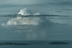 Clouds over the Irish Sea (PSHiggins) Tags: sea cloud lighthouse storm point island coast puffin mon thunder ynysmon anglesey ynys penmon puffinisland