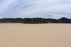Racetrack Playa and The Grandstand (daveynin) Tags: rock desert flat nps playa deathvalley monolith partlycloudy drylakebed