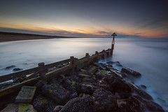 Let Sleeping Sunsets Lie (russellcram) Tags: sunset water clouds nikon rocks long exposure harbour d750 groyne sluice seaton 1635mm