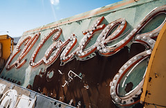 el cortez (almostsummersky) Tags: travel sky signs sign lights us spring rust paint neon unitedstates lasvegas nevada signage bulbs weathered restoration neonsign script outline sunflare elcortez neonmuseum neonboneyard