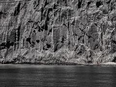 Woman in Red (dumsumdumfai) Tags: blackandwhite cliff toronto contrast landscape rocks dramatic reddress harsh urbanlandscape blackandwhitephoto landscapephotography manandnature flatperspective