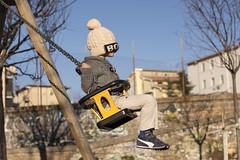 in the air, blindly (valerio valeri) Tags: portrait motion colors children 50mm moving outdoor valeri valerio