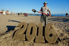sculpting the new year (KevinIrvineChi) Tags: santa new eve blue red sea people sculpture sun mer playing art beach public hat proud standing beard outside outdoors handle glasses bill sand couple artist outsiderart december day shadows outdoor sony sunny bluesky pride pacificocean cruz wharf years shovel creator 31 municipal lateafternoon cowell 2016 2015 dscrx100