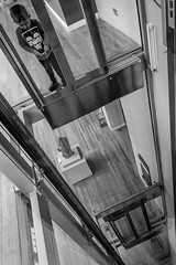 Long Way Down (CarnivoreDaddy) Tags: boy blackandwhite bw lines blackwhite kid nikon child lift elevator perspective kitlens son nationalmuseumofscotland 1855 lightroom leadinglines d3200