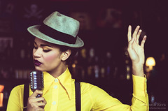 Rude Girl (Michela Riva Photography) Tags: portrait woman girl beautiful hat fashion yellow club vintage model singing masculine ska makeup rude style indoor retro jamaica sing singer 70s microphone 1970 elegant styling madeinitaly rudeboy rudegirl blackmodel