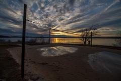 Volleyball Net (Mr_Samson) Tags: longexposure sky tree net water clouds nc outdoor dusk northcarolina volleyball volleyballnet longexposurephotography jordanlakestaterecreationareanlakestate jordanlakestate ncraleighraleigh nccaryweathersunlight