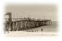 Brian_OBX 91 LG Sepia Vignette_062815_2D (starg82343) Tags: vacation people seascape building beach sepia architecture outside outdoors pier wooden nc sand sandy shoreline northcarolina monotone structure pilings recreation grayscale activity 2d picturesque outerbanks seashore eastcoast fishingpier waterscape brianwallace avalonfishingpier