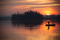 A Sun Behind (Daniele Pauletto) Tags: winter light sunset shadow sky cloud sun lake clouds lago boat fisherman italia tramonto nuvole outdoor dusk ombra silouette sole pusiano dpphotography