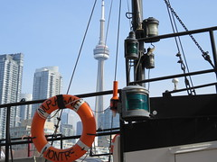 Viewed through (Kaarina Dillabough) Tags: sky lake toronto water boat ship cntower view harbour lamps lifebuoy