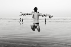 Let's fly ... (R.I.Jewel) Tags: sea people man motion blackwhite bangladesh coxsbazar