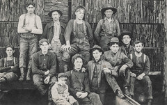 Group of men and boys in overalls (simpleinsomnia) Tags: old white man black monochrome vintage found blackwhite kid workers child antique snapshot photograph vernacular occupational rough foundphotograph