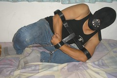 Locked in T-shackle (asiancuffs) Tags: prison shackles hood gag handcuffs prisoner handcuffed
