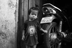 Kid  Phnom Penh (Julien Mailler) Tags: world street travel portrait people blackandwhite white black kids asian julien kid asia cambodge cambodia cambodian khmer motorbike moto asie phnom nationalgeographic penh asiatique reflectionsoflife lovelyphotos jules1405 cambodgien unseenasia earthasia mailler