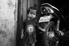 Kid  Phnom Penh (Jules en Asie) Tags: world street travel portrait people blackandwhite white black kids asian julien kid asia cambodge cambodia cambodian khmer motorbike moto asie phnom nationalgeographic penh asiatique reflectionsoflife lovelyphotos jules1405 cambodgien unseenasia earthasia mailler