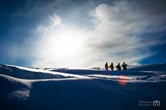 Staring at the sun (Laurent VALENCIA) Tags: snow france alps building sports montagne alpes canon buildings woods ciel surfers neige foule savoie laplagne matin pistes skieurs frenchalps randonne immeubles sapins glisse 50mpx 5dsr