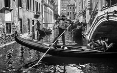 Going Under in Venice (derek.dpr) Tags: bridge venice bw italy black reflection monochrome reflections mono canal italia noir candid olympus gondola venise venezia bianco nero gondolier omd em5 veniceitalybw