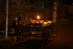 Don't be so MELON-CHOLY !! (N A Y E E M) Tags: street light lamp night raw availablelight windshield untouched bangladesh seller watermelons kerosene unedited chittagong sooc rickshawvan norahmedroad