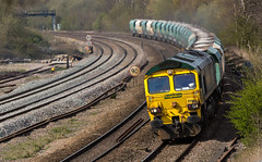 Freightliner Class 66/6 No. 66603 at Clay Cross on 21st April 2016 with a Tunstead to Brentford loaded service. (kevaruka) Tags: light england sun color colour green art colors sunshine yellow composition canon geotagged outdoors photography spring europe flickr colours afternoon derbyshire vivid rail railway sunny telephoto april 5d frontpage freight britishrail springtime sunnyday lightroom freighttrain 2016 freightliner class66 networkrail railfreight claycross tupton canon5dmk3 5dmk3 canonef100400f4556l 5d3 5diii canoneos5dmk3 telephototrains 21042016