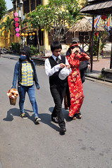 Feeling the heat (Roving I) Tags: flowers costumes sun vertical walking photography suits caps vietnam hoian heat brides tradition facemasks bridalcouples