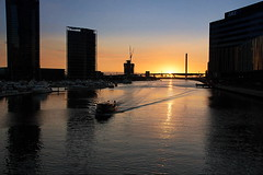 Sunset River Cruising at Docklands (vcostanz) Tags: sunset sun seascape water silhouette skyline port marina canon river harbor boat twilight sailing cityscape waterfront dusk cruising australia melbourne victoria boating docklands siluette yarrariver sagoma waterripple canon650d boltebright