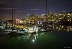 Night Reflections (Clayton Perry Photoworks) Tags: canada skyline night vancouver buildings reflections boats lights spring bc stanleypark coalharbour explorebc explorecanada