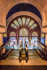 QVB escalator (Janet Marshall LRPS) Tags: windows escalator sydney wideangle arches stainedglass symmetry cbd qvb romanesquerevival queenvictoriabuilding stupidiso